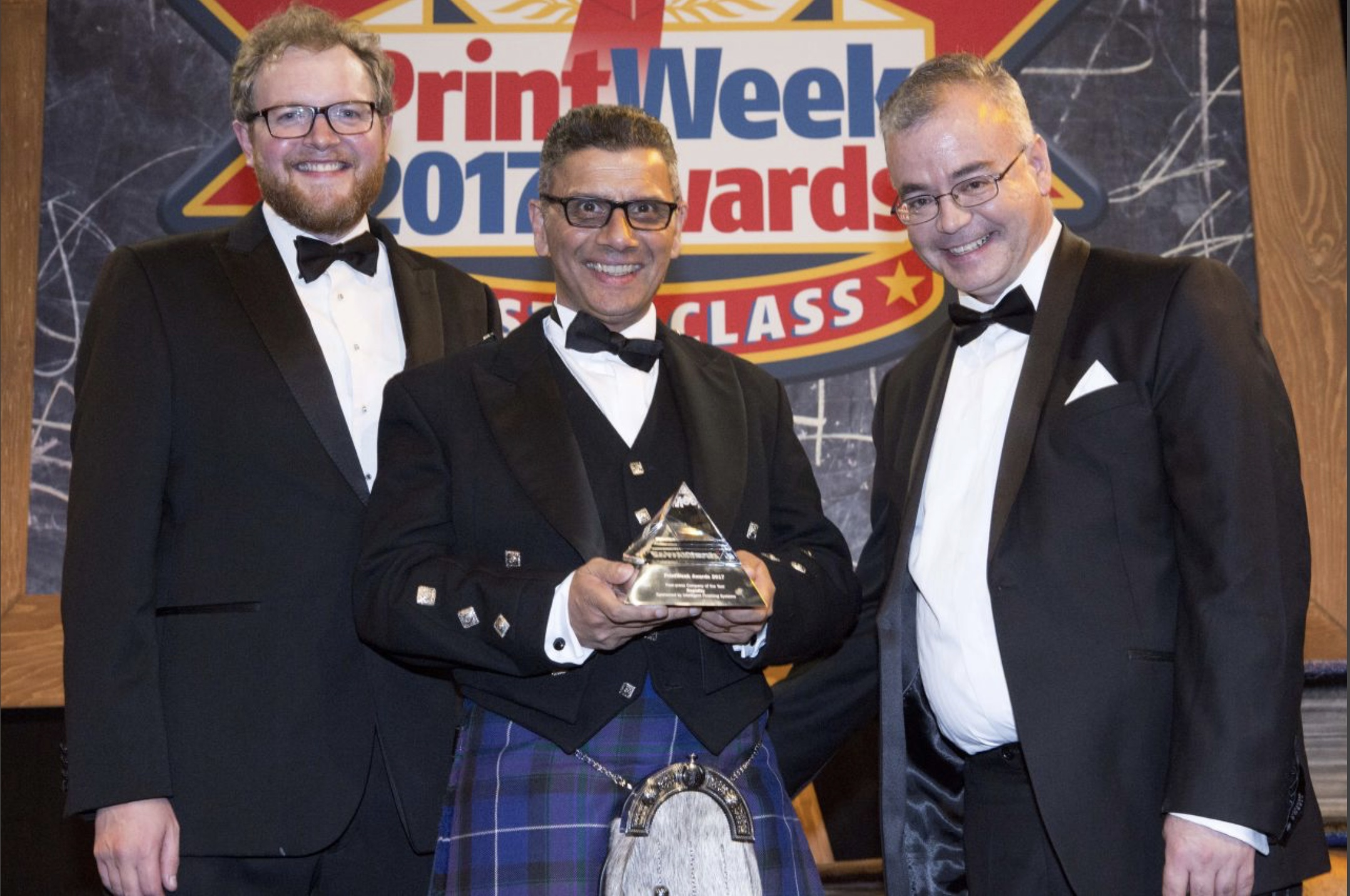 Chris Narayan, Bindery Manager, collecting his well deserved award for Post-press Company of the Year.