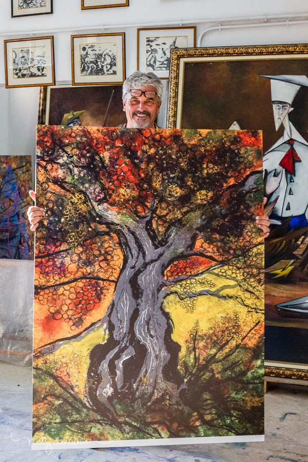 Jarl Goli with a big print of The tree of Love, Museo Delso, Spain  Photo by Nelly del Arbo