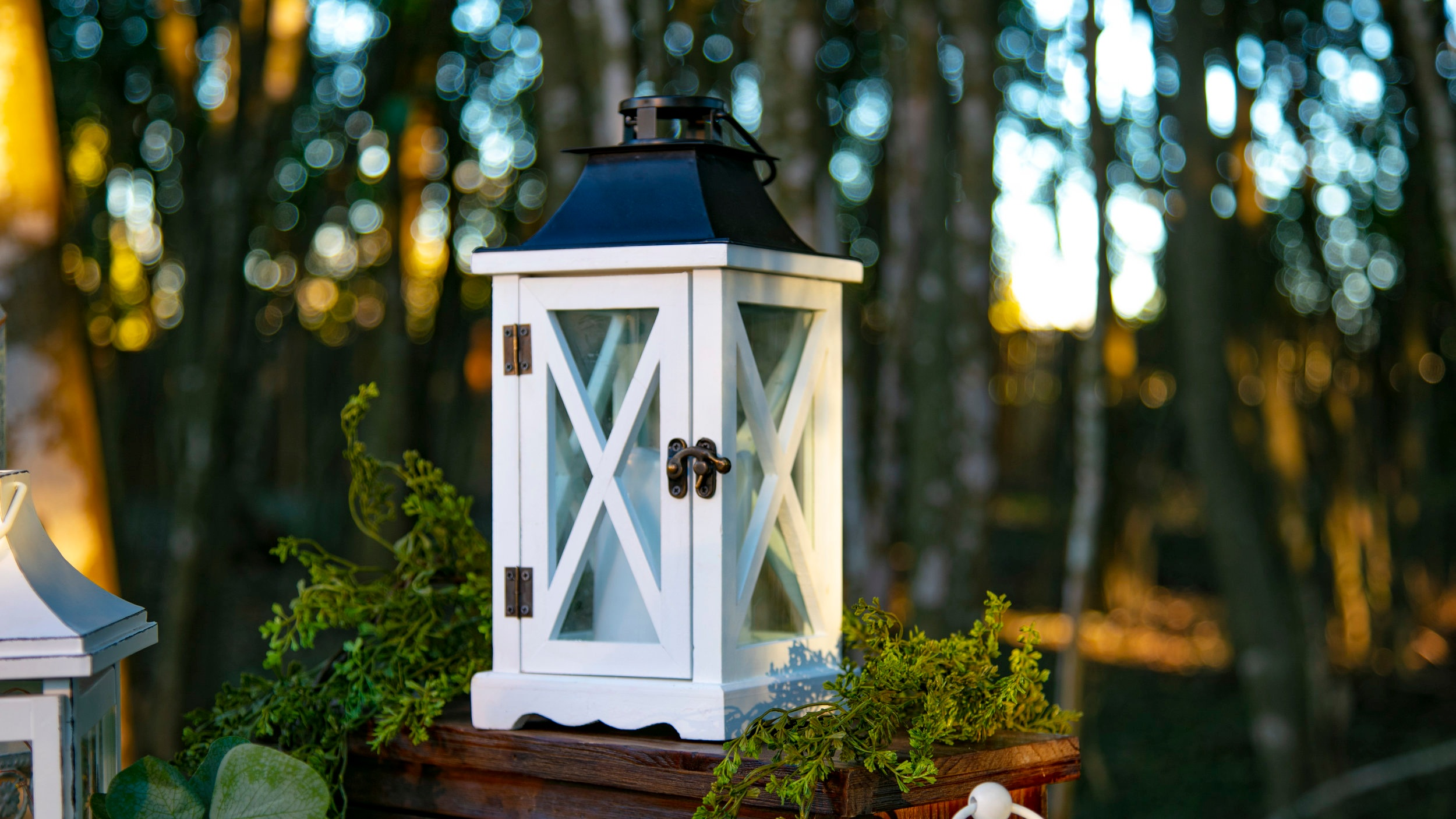 White Wooden Lanterns with Metal Black Top (criss-cross)  Qty: 6  Rental Price: $15.00 each / $50.00 for all 6
