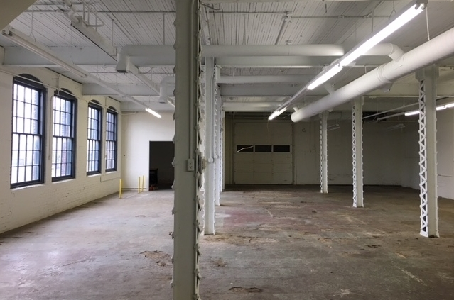 Warehouse - Almost 3,000 square feet of first floor, heated, unfinished warehouse space with lots of light and large windows.