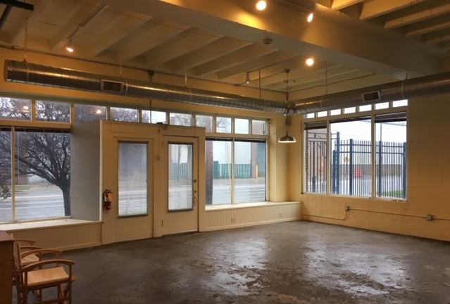 Storefront - A former artist's studio and gallery, the storefront space offers approximately 750 square feet of open space, with small kitchenette area and private half bath with room to expand.