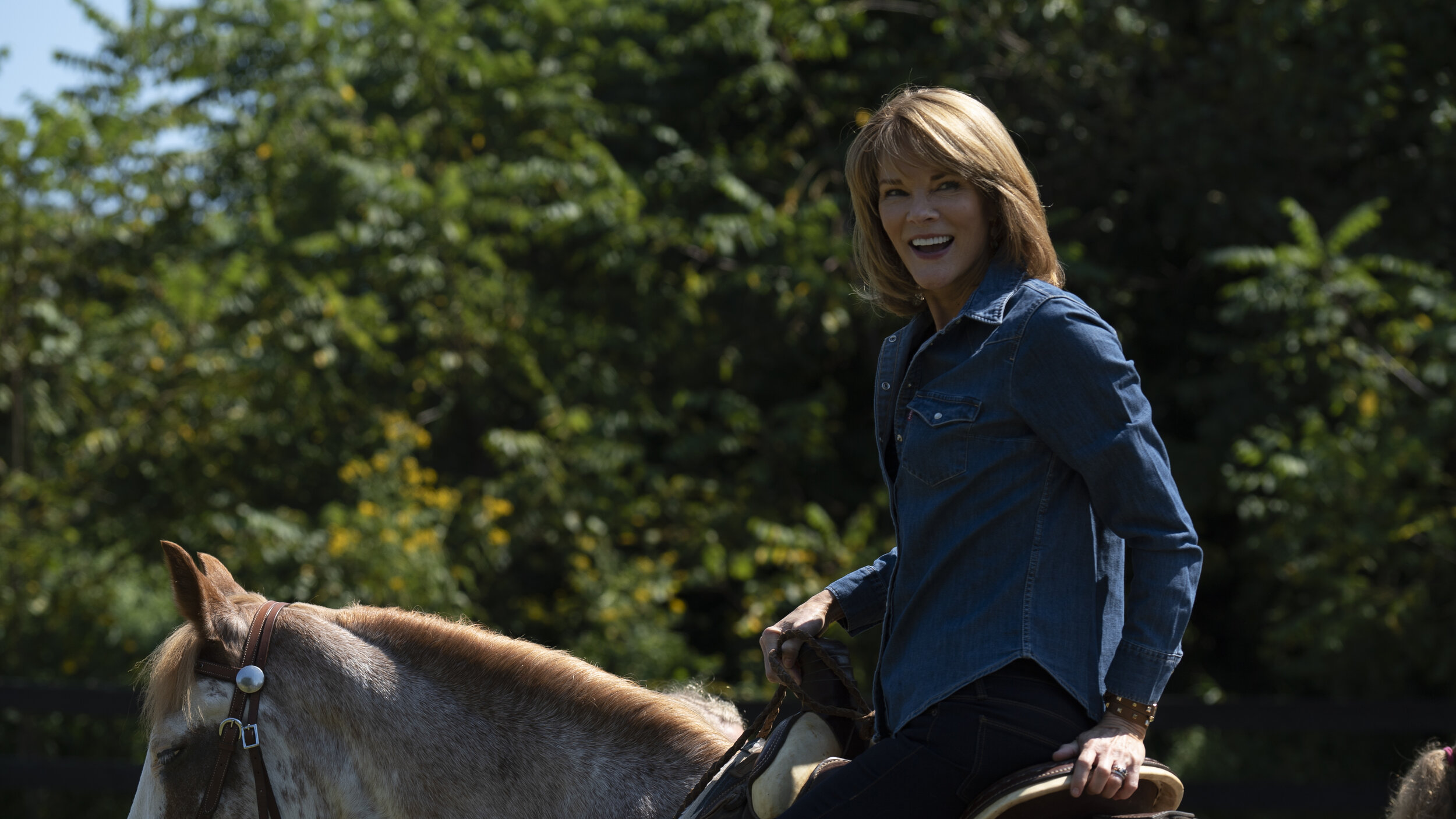 Carolyn McCormick with horse.jpg