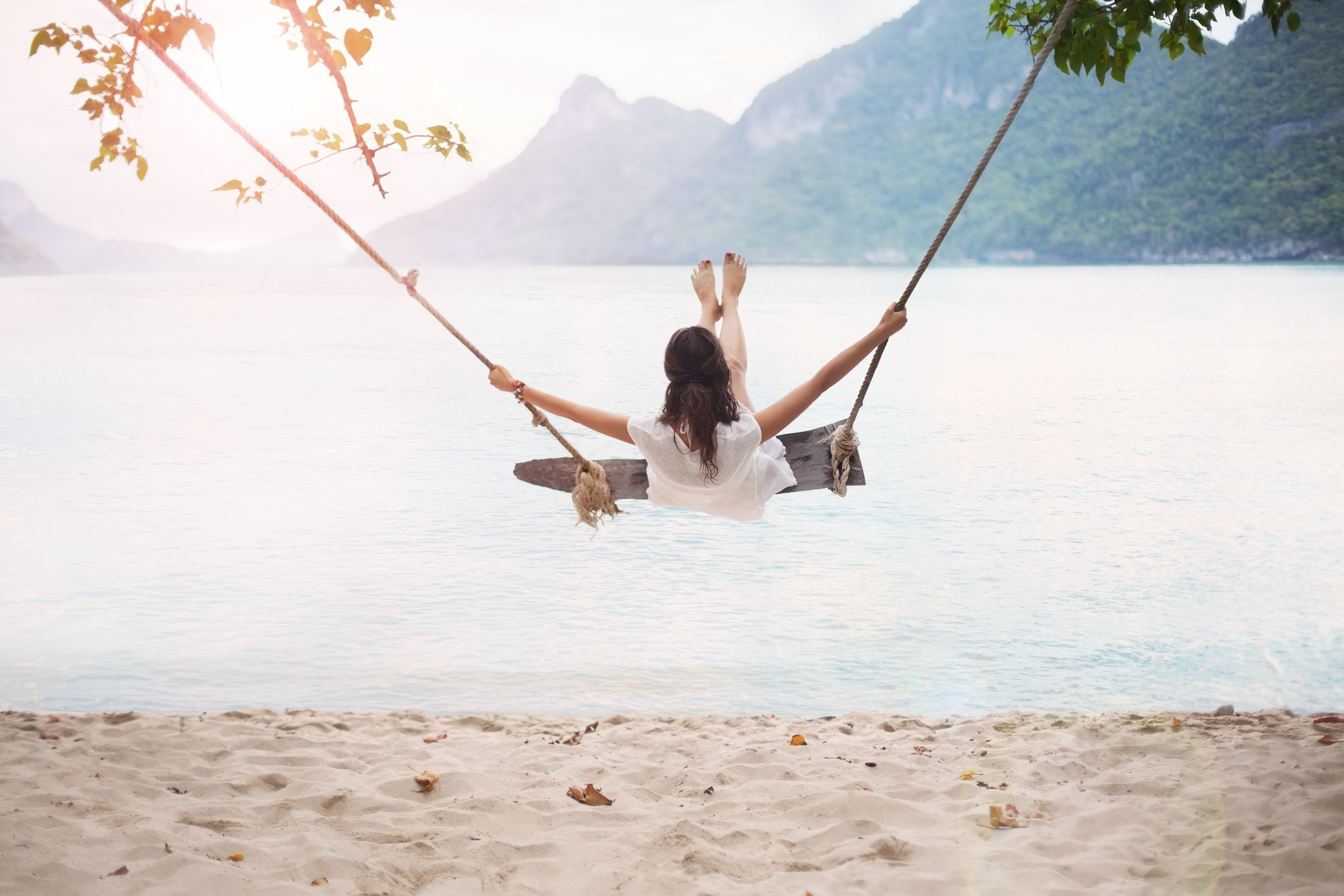 woman-on-swing-beach.jpg