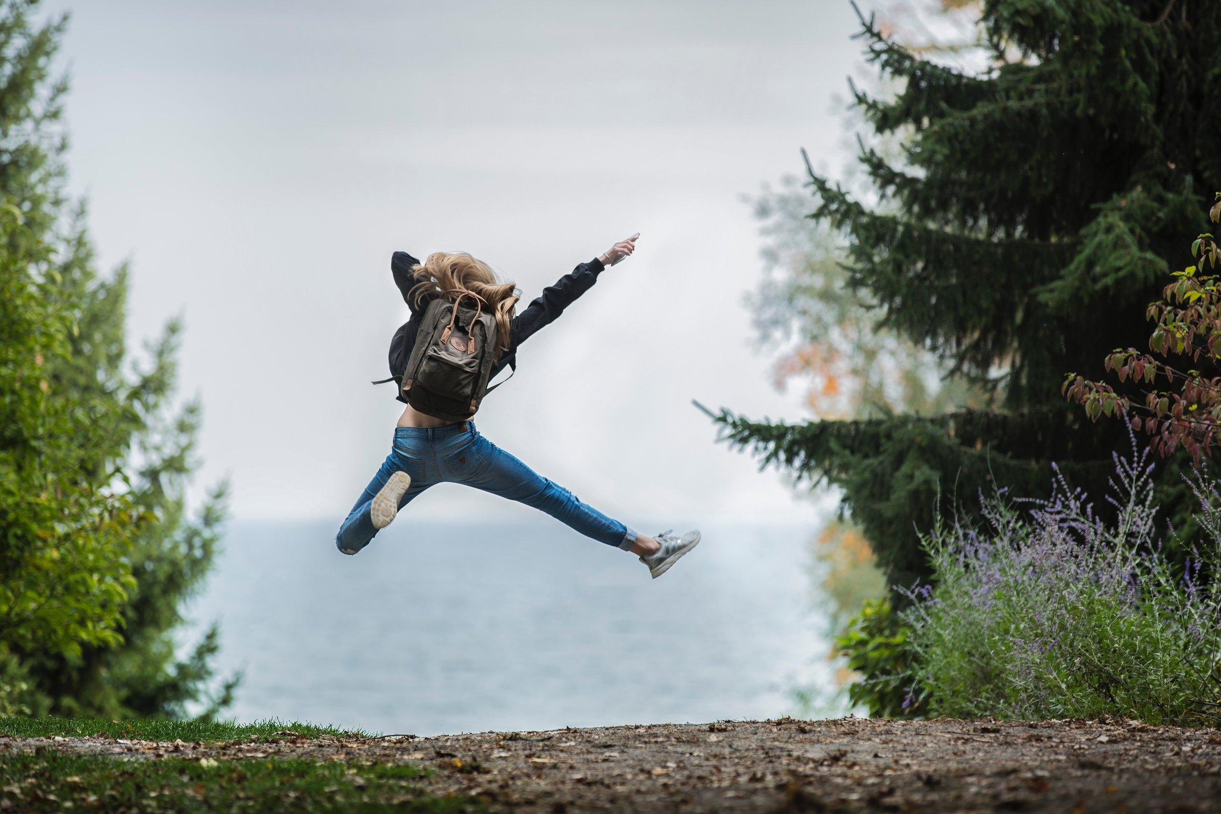 blonde jumping backpack.jpg