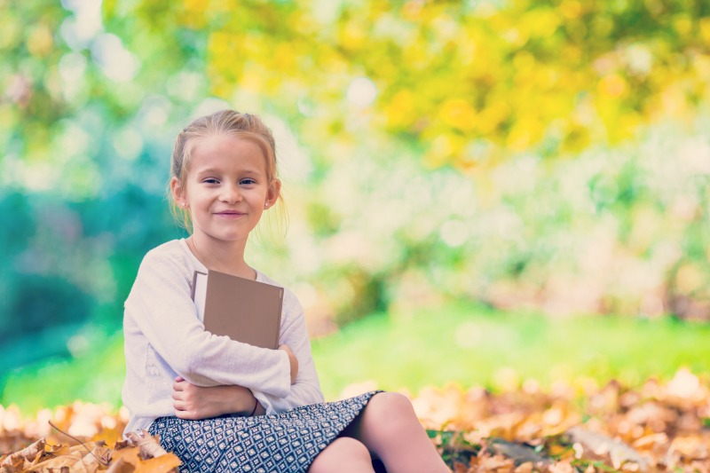 young girl with book  resized.jpg