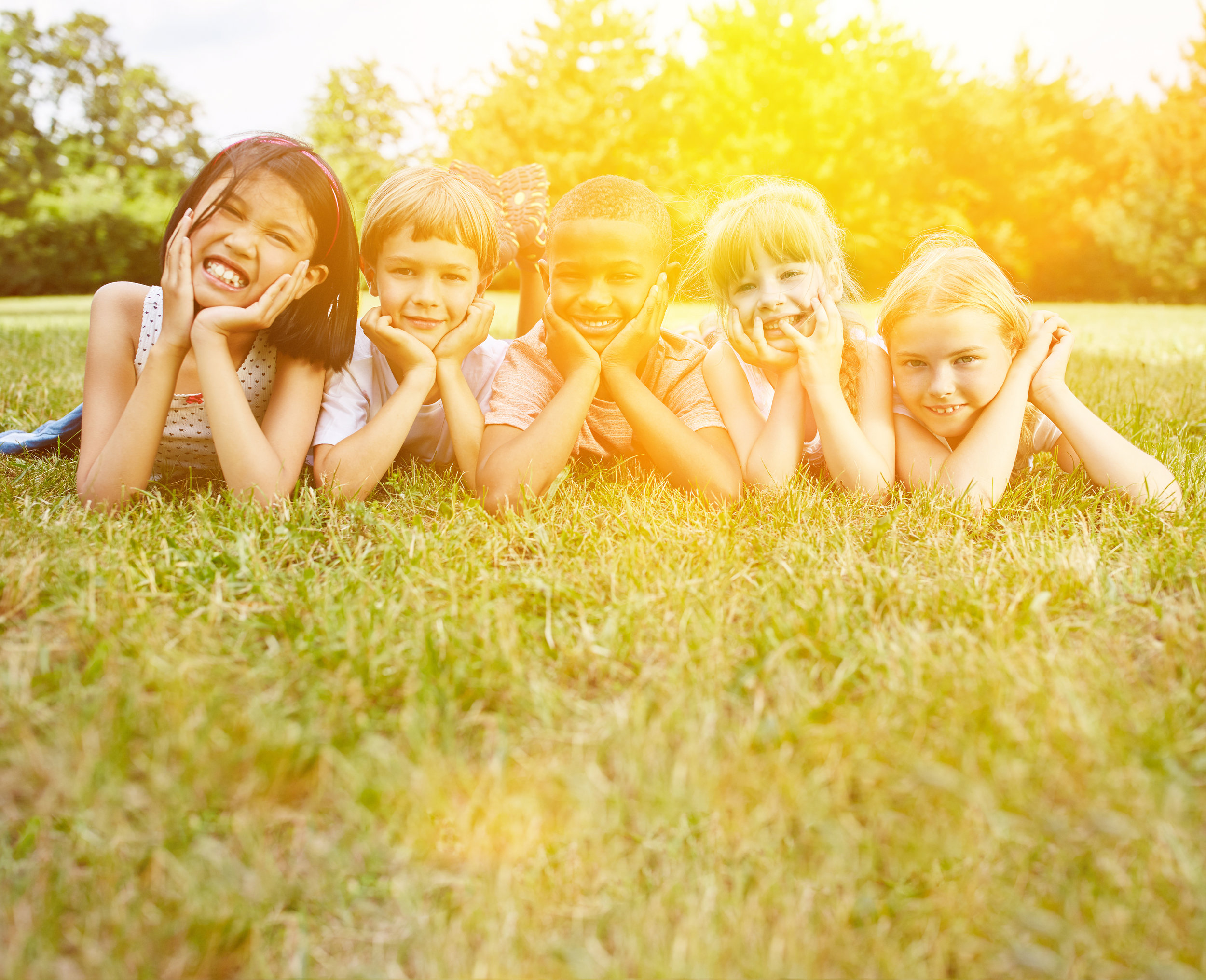 Happy kids grass sunshine.jpg