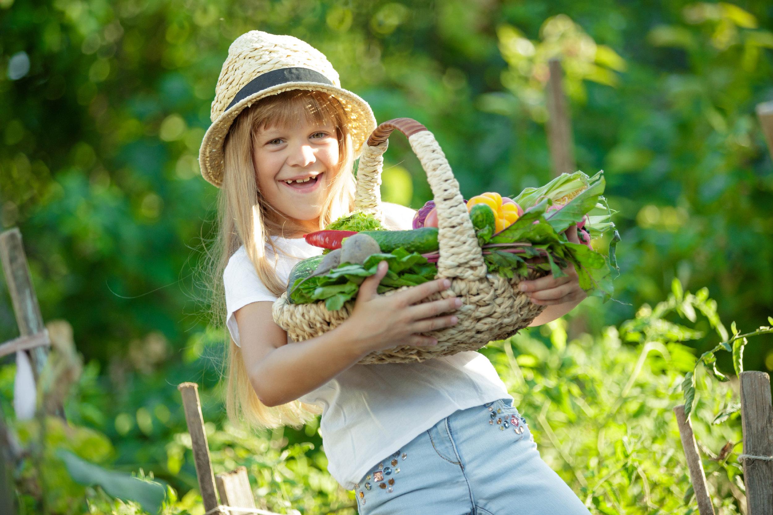 girl basket vegetables.jpg