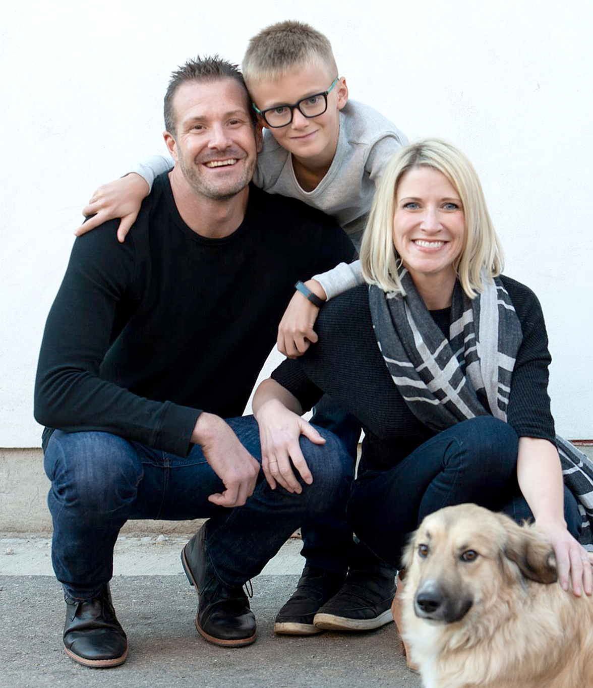 Jamie with her husband Chris, her 8-year old stepson Jackson, and their dog Bru
