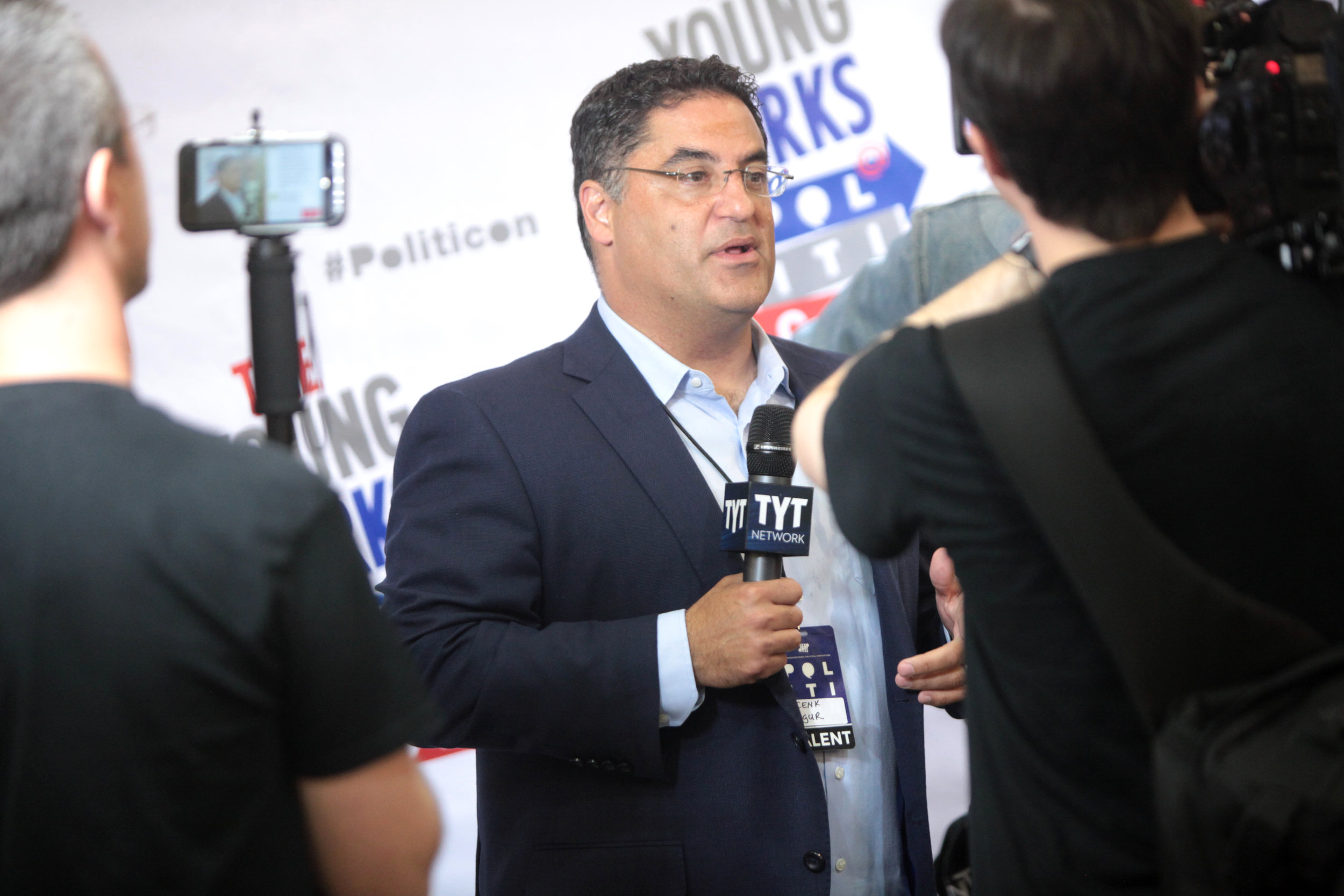 Cenk Uygur speaking at the 2016 Politicon at the Pasadena Convention Center in Pasadena, California.  Photo by Gage Skidmore