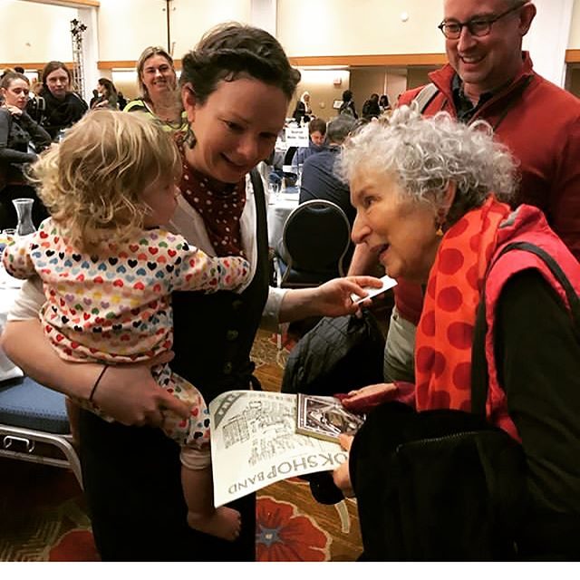 A little snap of one of my hero's, #margaretatwood saying hi to my niece and sister in law at a @bookshopband gig in the US. If you zoom in on her hand she's holding a piece of artwork I made for one of their album covers. Small thrills!