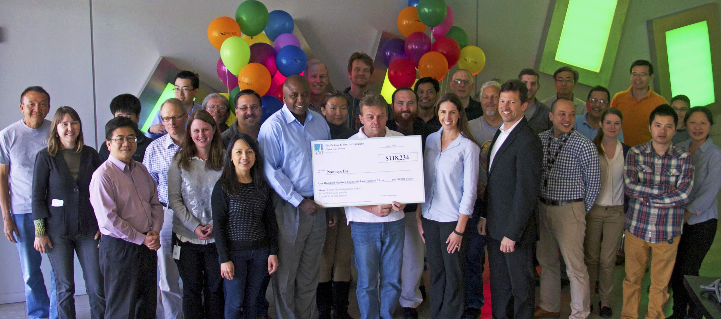 PG&E representative Jill Adams presenting the Energy Efficiency Program incentive check to the team at Nanosys for energy savings of over 800,000 kWh at the company's Milpitas, CA headquarters