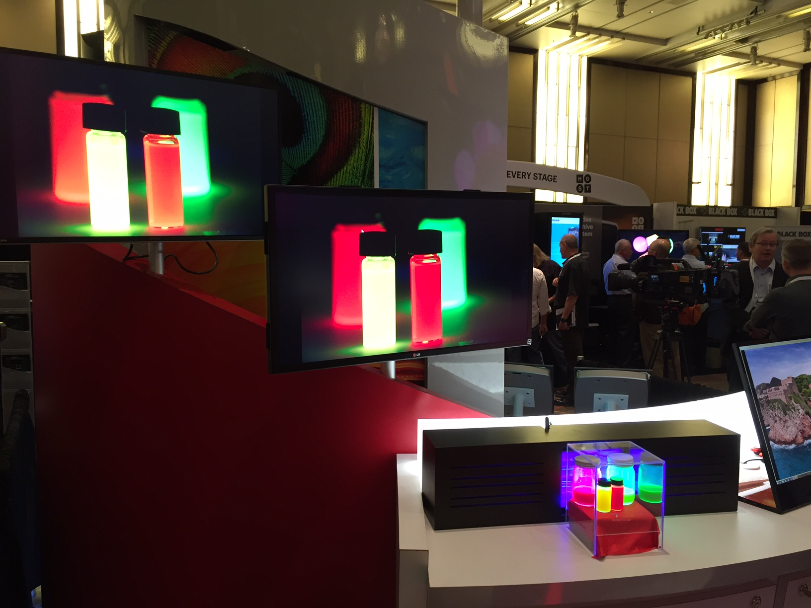 Rec.2020 Quantum Dots on display at SMPTE on a rec.2020 display! In the above demo, 3M is showing red and green Quantum Dots with rec.2020 wavelengths (clear box at lower right) next to an accurately reproduced image of those same dots on the 93% rec.2020 display (above and left).