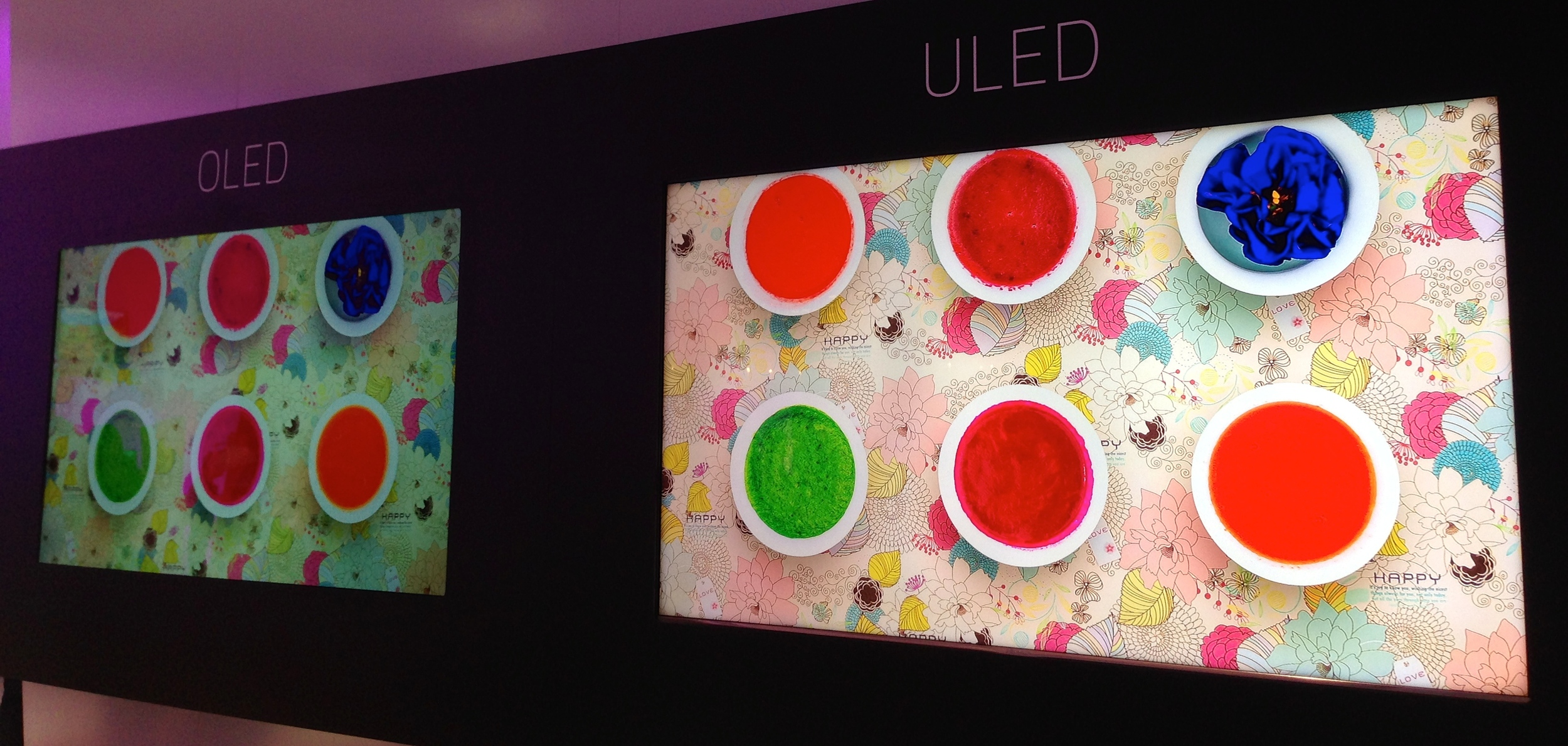 """Hisense dynamic backlit, Quantum Dot """"ULED"""" LCDs (right) take the Pepsi challenge with OLED at IFA 2014 in Berlin."""