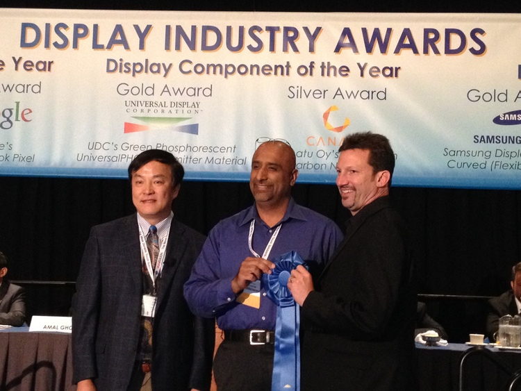Nanosys CEO Jason Hartlove (right) and Dolby's Ajit Ninan (center) accepting the Best in Show award from Apple's Wei Chen at the 2014 Display Industry Awards in San Diego.