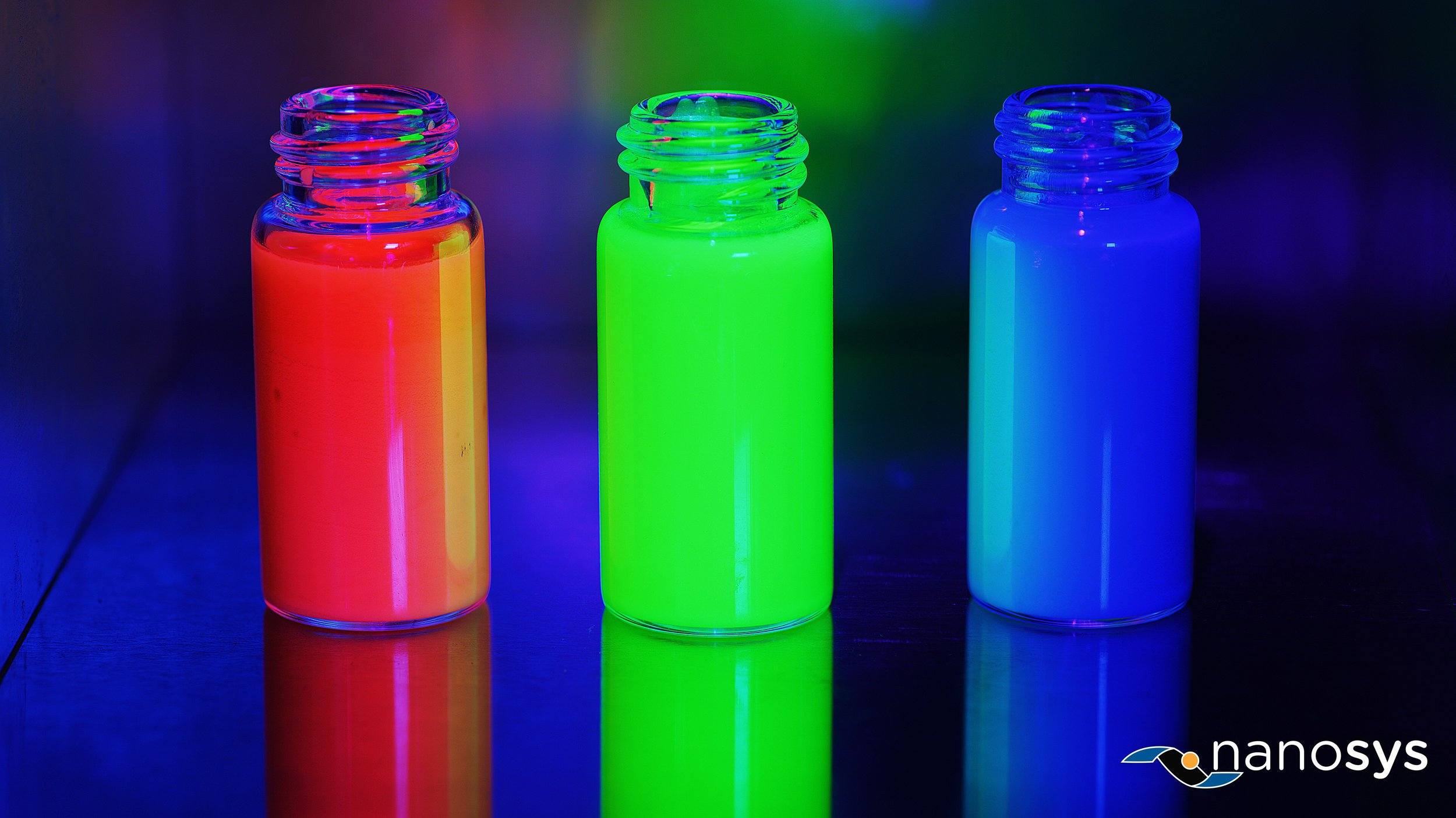 Nanosys Heavy Metal Free Quantum Dots: Image shows vials containing Nanosys state-of-the art Quantum Dot technology emitting red, green and blue light.