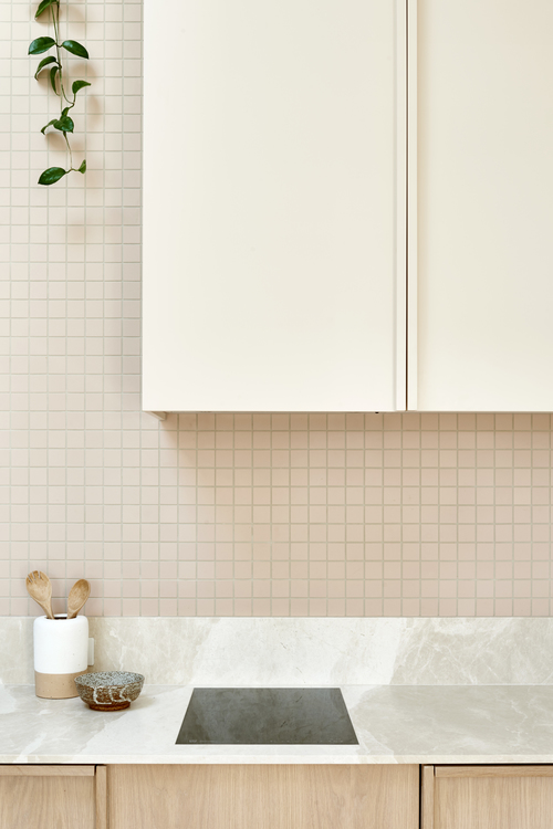 Marble sealed and retuned up the splash back to ensure tiles are easier to clean. Photography Nikole Ramsay.