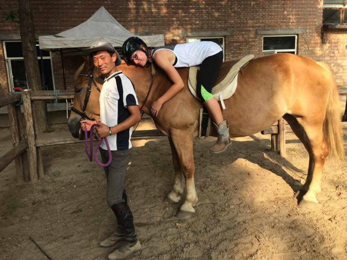Our new horse Muer at the end of training session with Xiao Zhao & Saige.