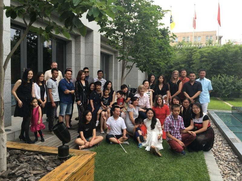 Children and parents from HOPE, volunteers from US, Bethel residents and Qu Laoshi, and HKJC members at the Hong Kong Jockey Club in Beijing.
