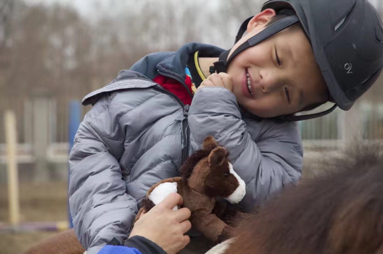 Child with Toy Horse