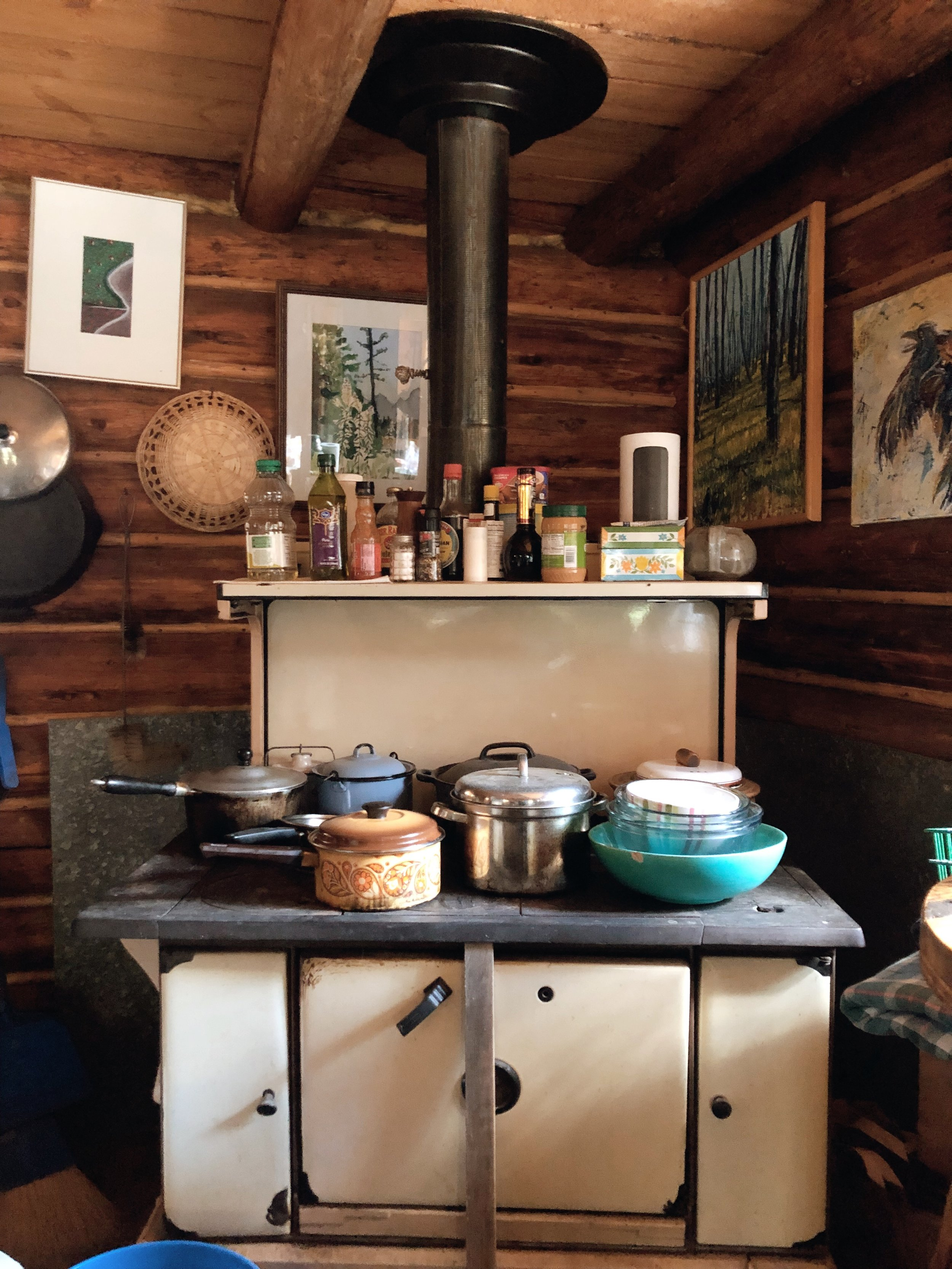 Peter's stove, located in the corner of his space, surrounded by artwork and kitchen supplies.