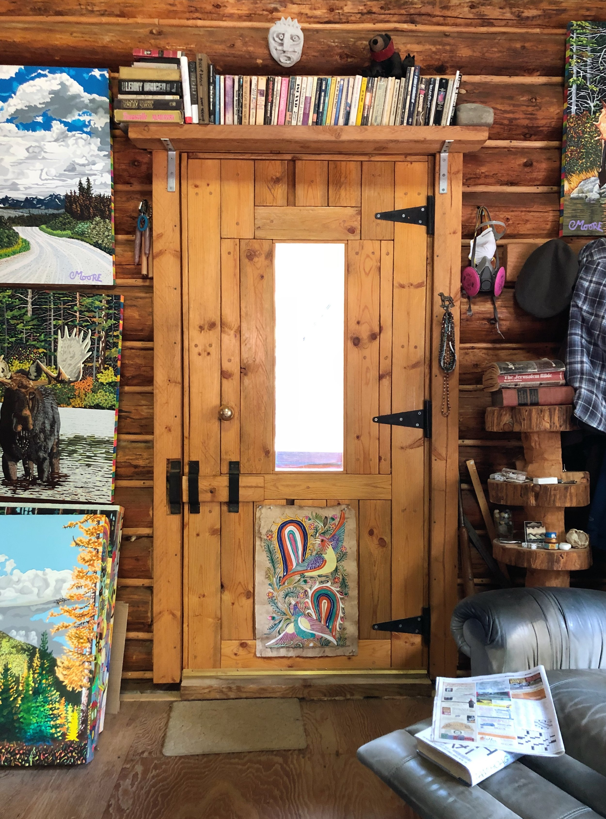 Front entry door, paintings, and a lounge chair.