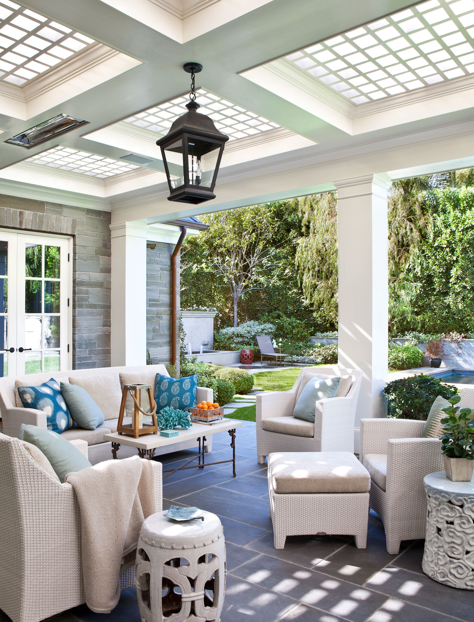 loggia-outdoor-dining-rear-patio-traditional-stone-house-ward-jewell.jpg