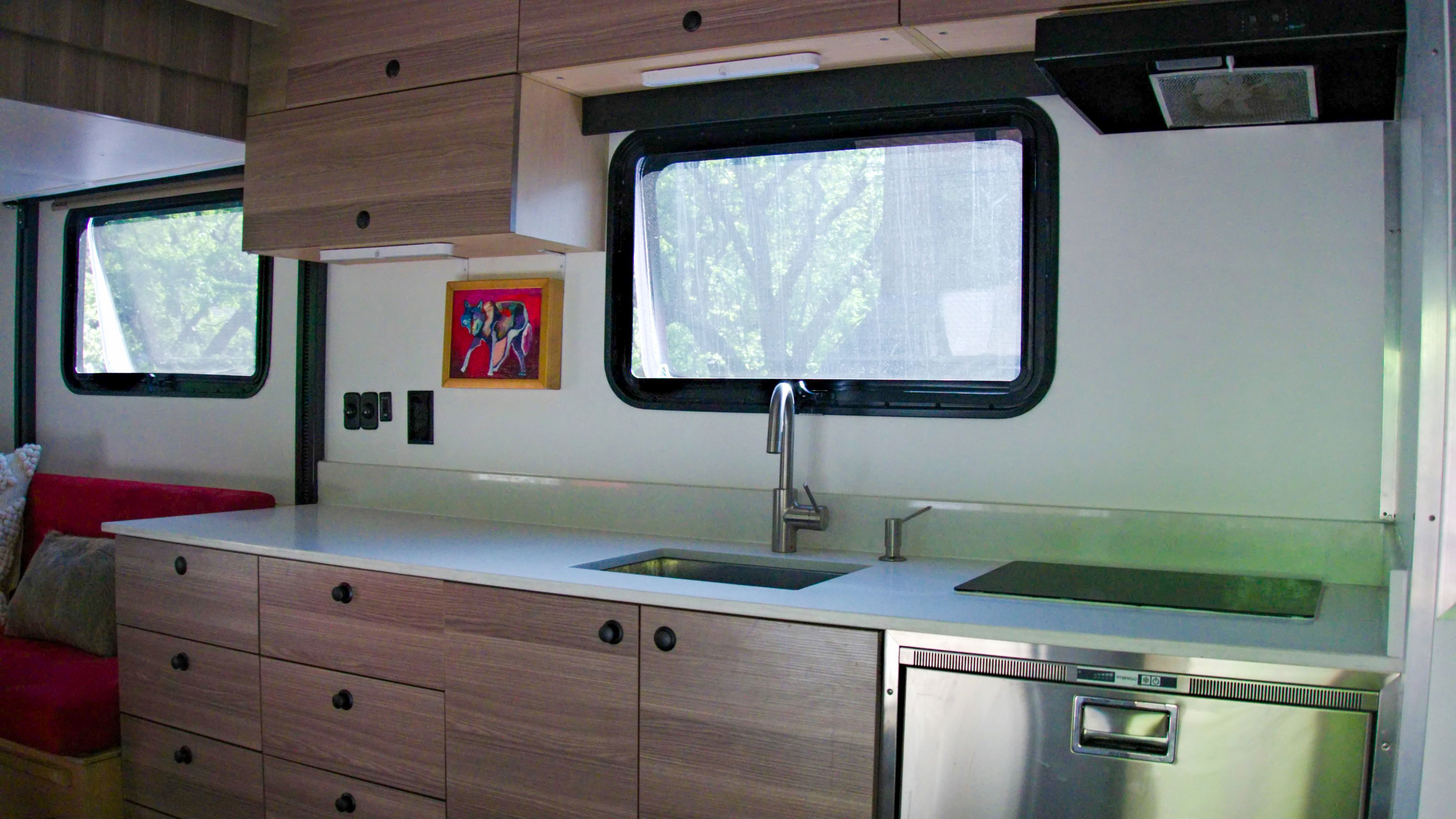 kitchen with dual burner induction stove & stainless steel sink