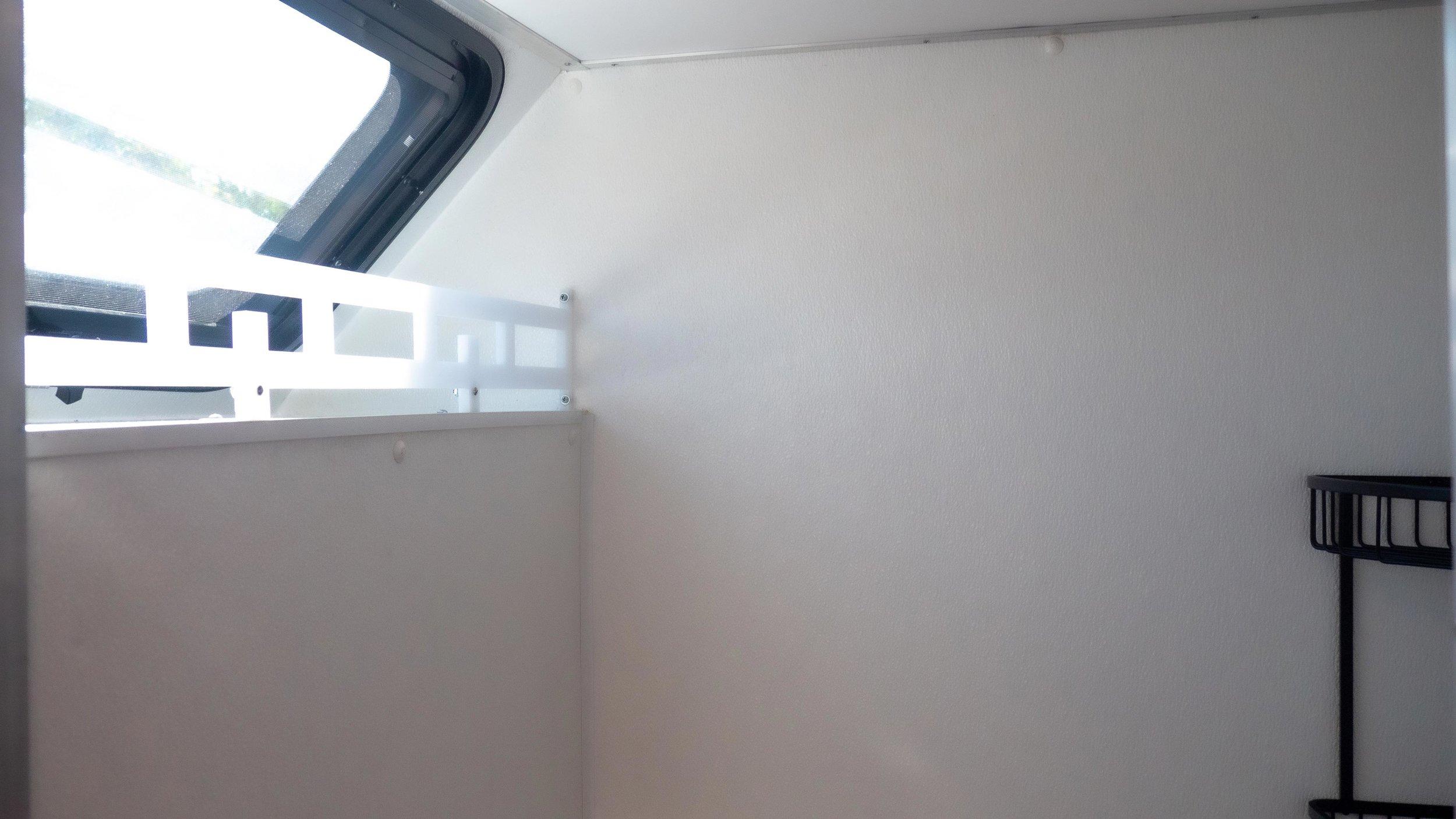shower with storage rail and window