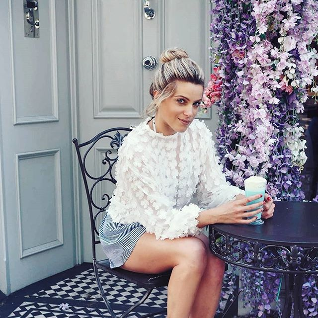 @oliviacoxlondon in our Peony top