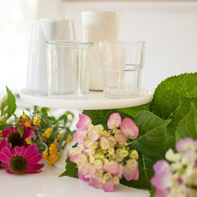 You don't need your flowers professionally arranged to have a very welcoming display around your house. Simply grab whatever containers you have on hand and make an eclectic variety of wildflowers. It will do the trick, I promise