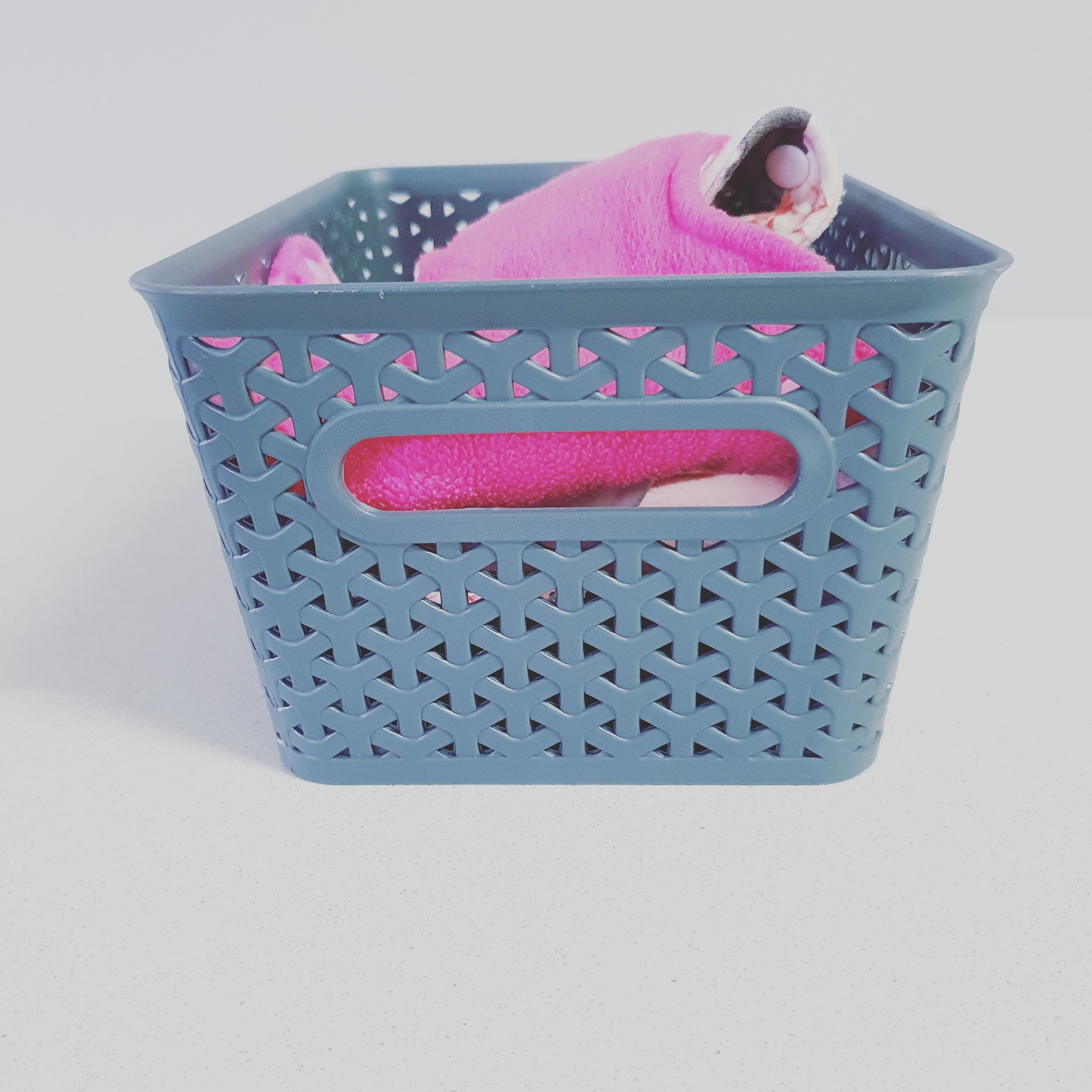 Basket for storing used pads