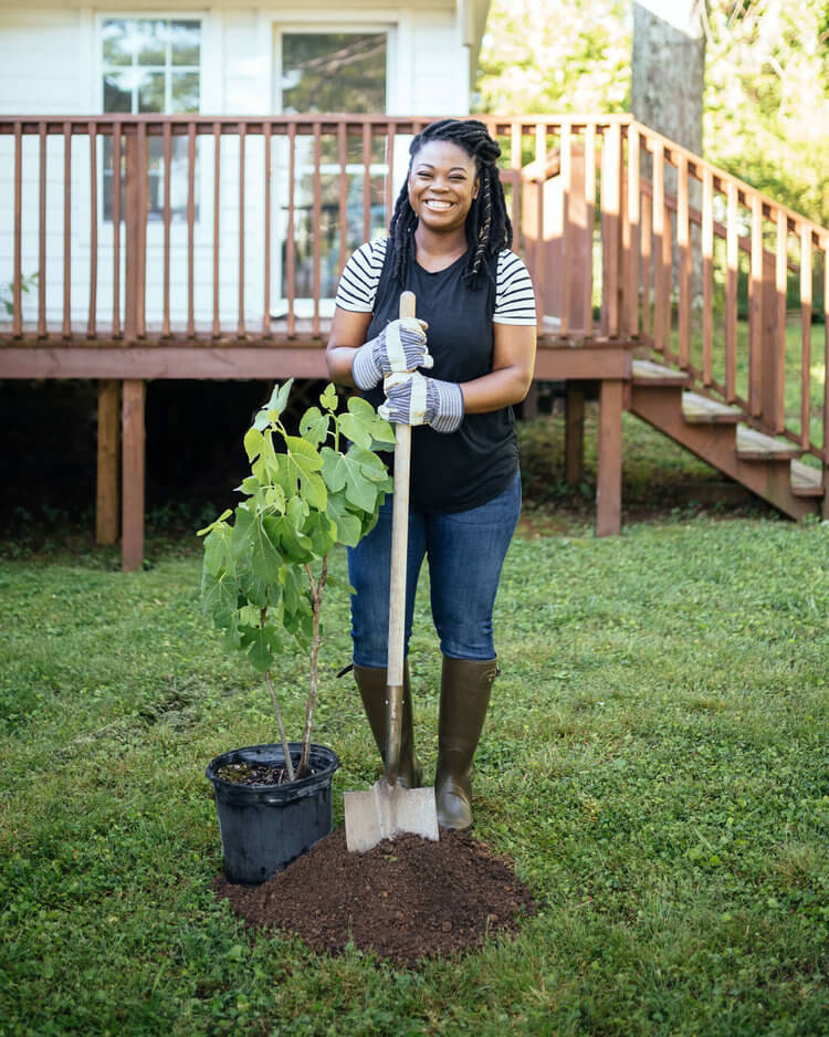 chattanooga-gas-woman-planting-tree-in-her-backyard.jpeg