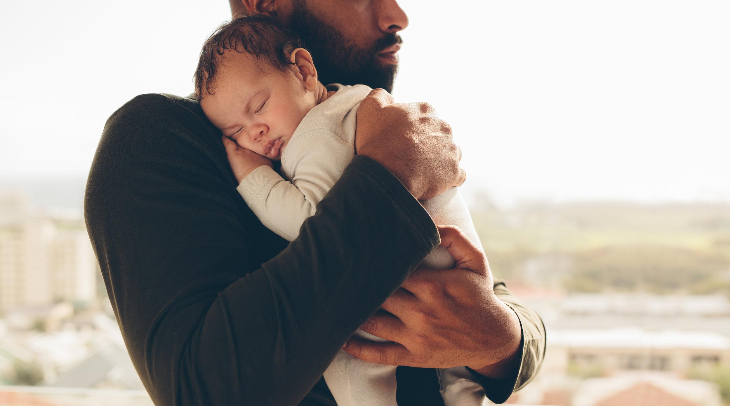 postnatal newborn and dad