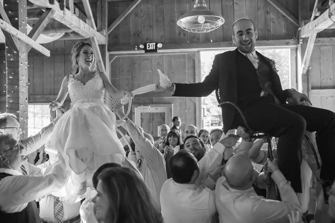 Raising the roof at the Olender/Eisenberg Wedding - photo by Oden &  Janelle
