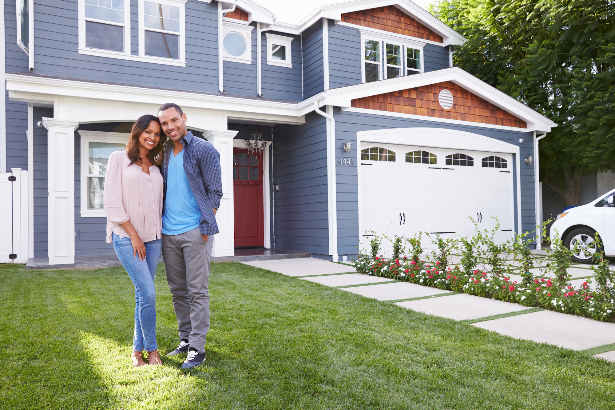Couple in front of new house.jpg