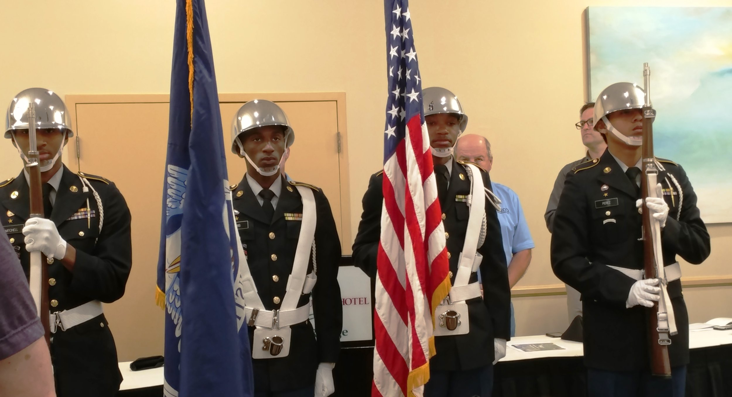 Broadmoor High School JROTC cadets present the colors at the BRECO FCU Annual Meeting