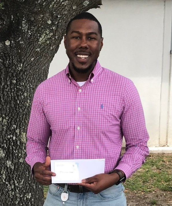 Entergy employee Donavon Anderson wins a Visa gift card from BRECO FCU