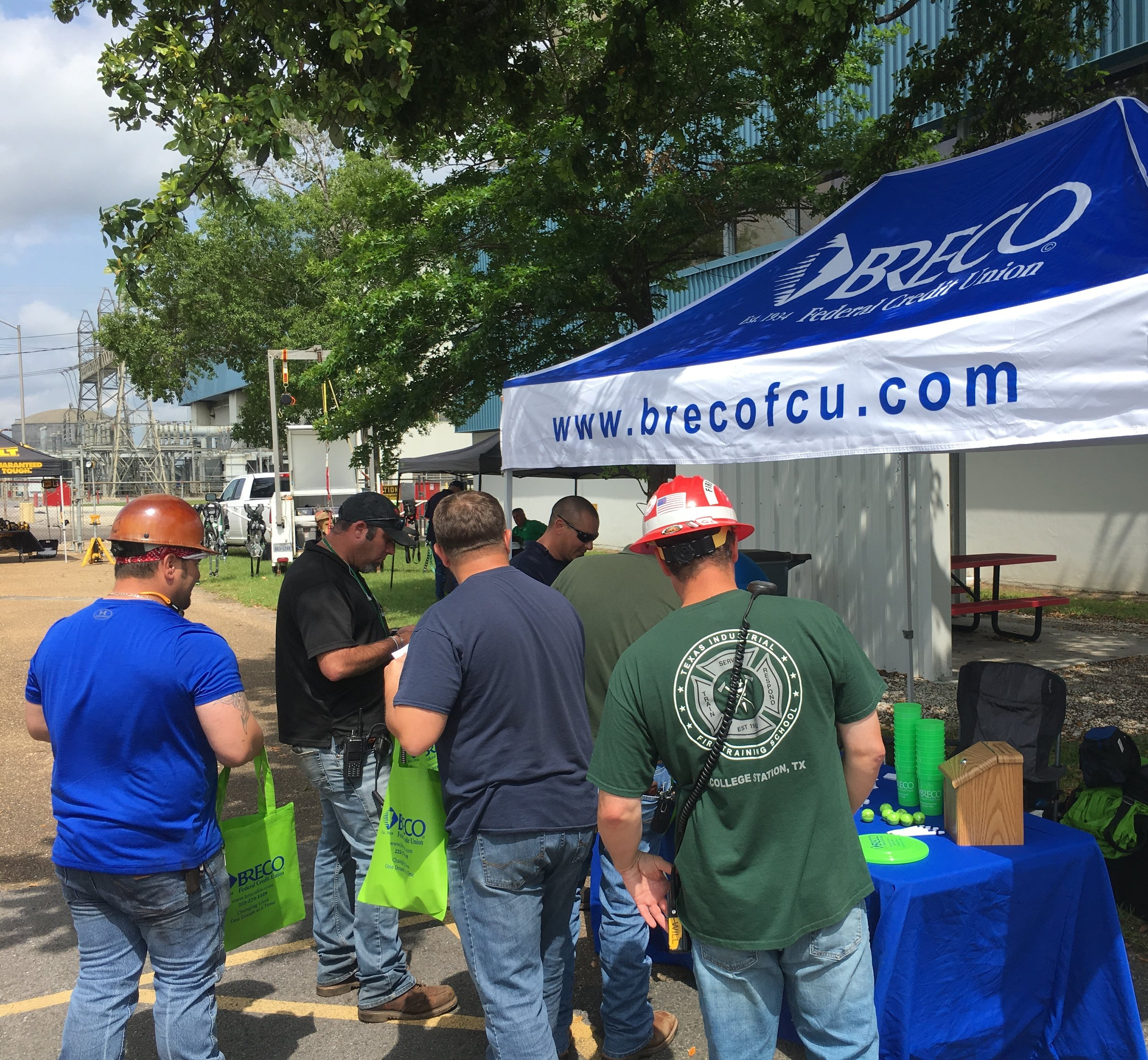 Entergy employees visit BRECO's booth at the Entergy Safety Fair in Westlake, LA.