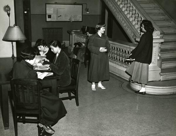 Students next to Milbank Hall staircase, circa 1948-1959.jpg