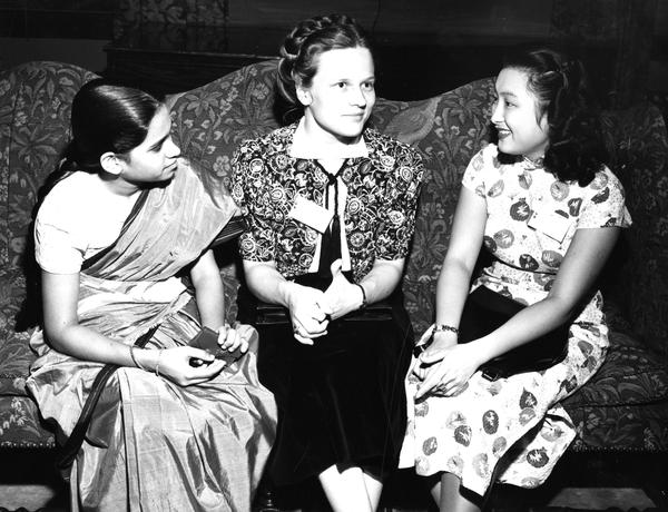 Three foreign students sitting on couch, 1948.jpg