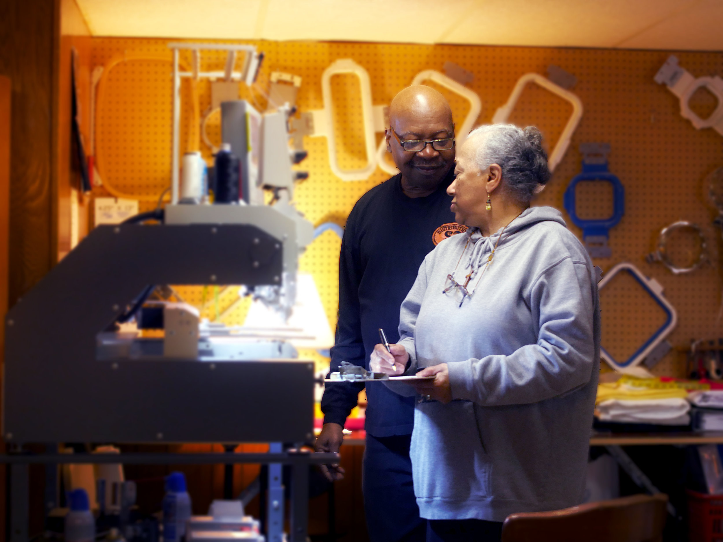 Calvin and Shellene Coleman in their home workshop
