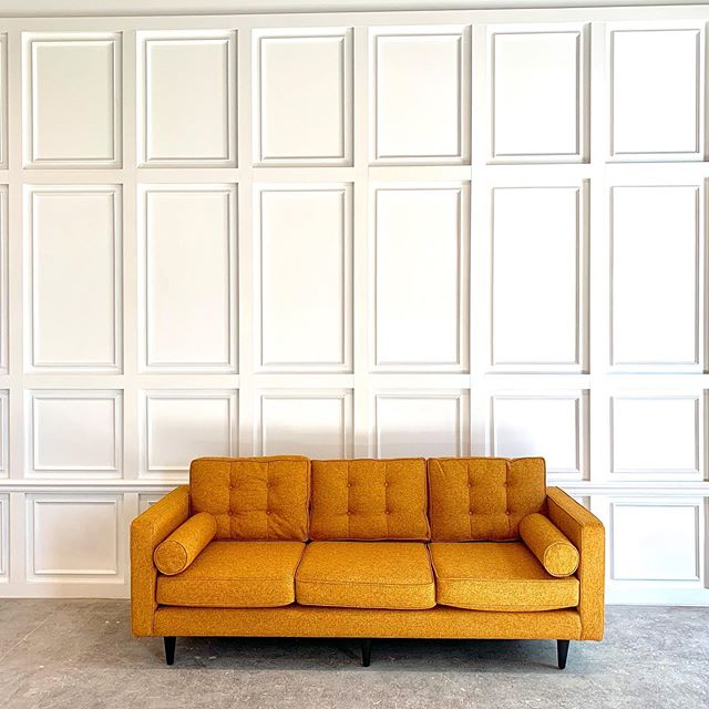 We just live our giant wainscoting feature wall and mid century modern sofa! What will you create here?