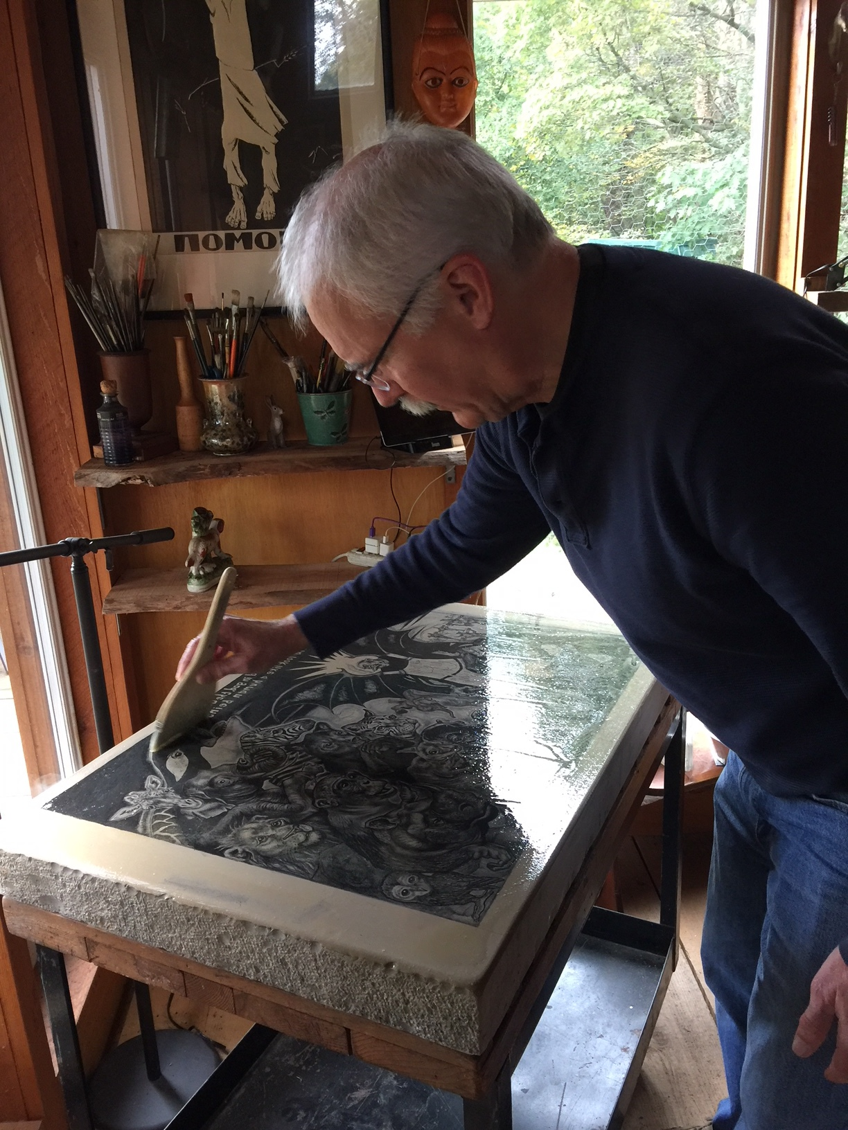 Tim etching a lithography stone in Sue Coe's studio, 2018.