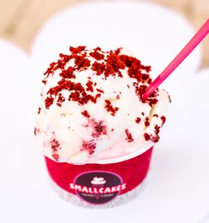 Creamy cream cheese ice cream layered with red velvet cupcakes.