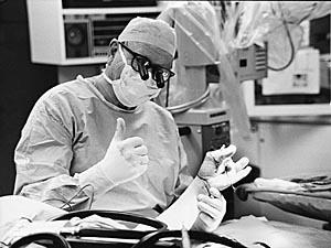 Harry J. Buncke in the operating room