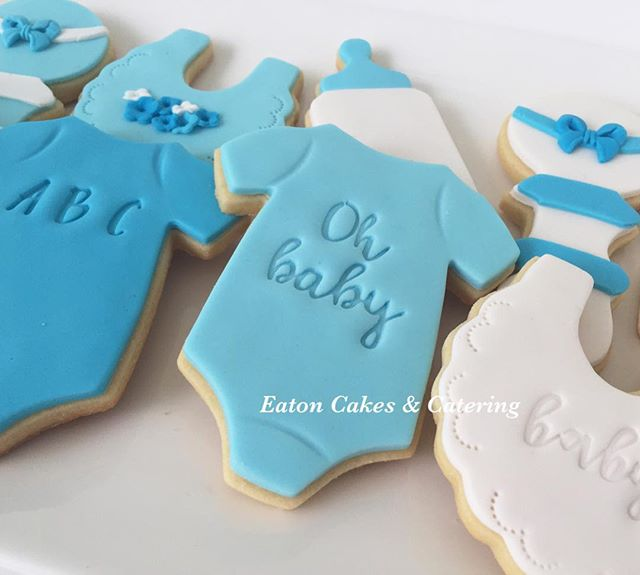 Baby boy themed cookies for Nichola's baby shower . I loved using my new alphabet embossing stamp set from @customcookiecutters  #eatoncakes #cookies #cupcakes #babyshower #babyboy #welcomebabyboy #jumpsuits #babybottle #babybibs #babyrattle  #macarthurnsw #lovelocal #customcookiecuttersaustralia