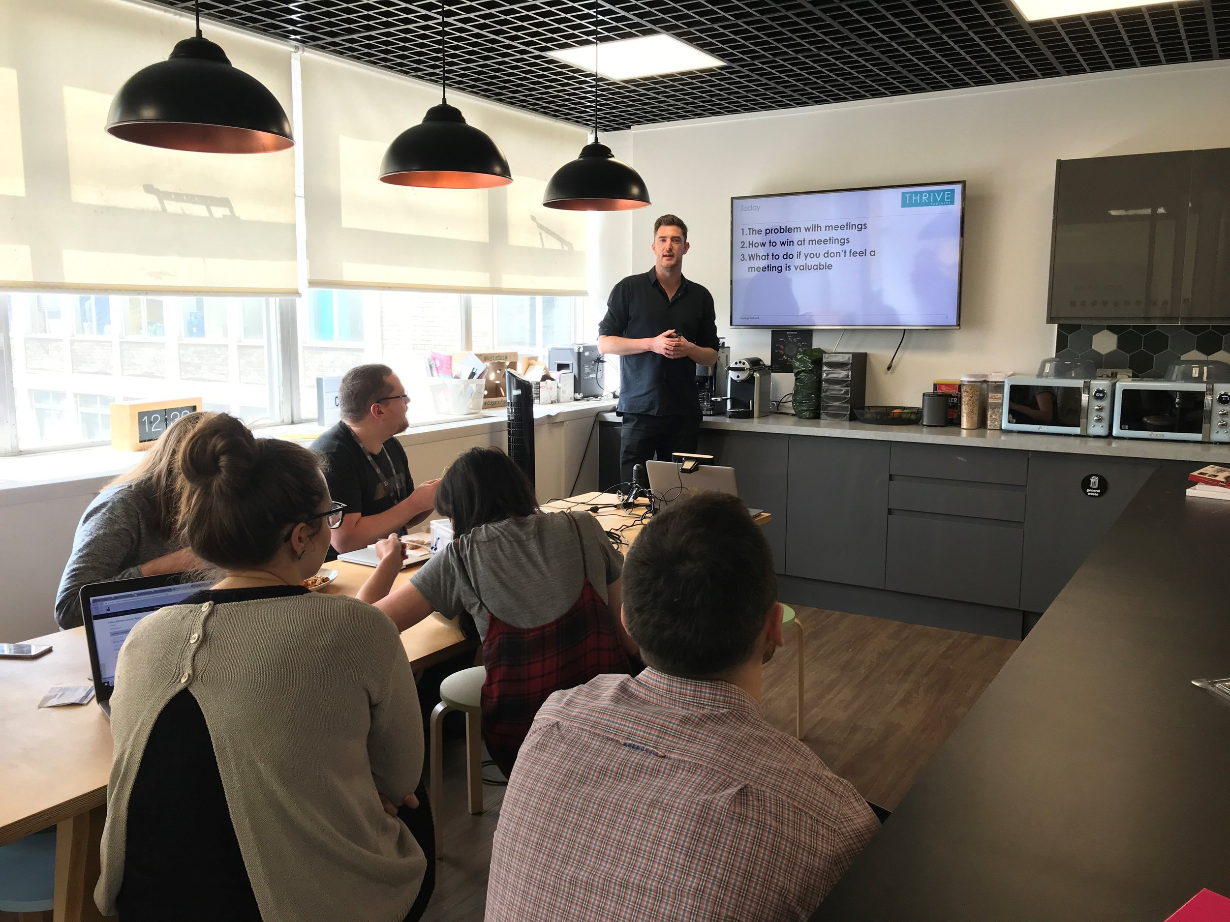 Onboarding clients at a lunch & learn session (2018)