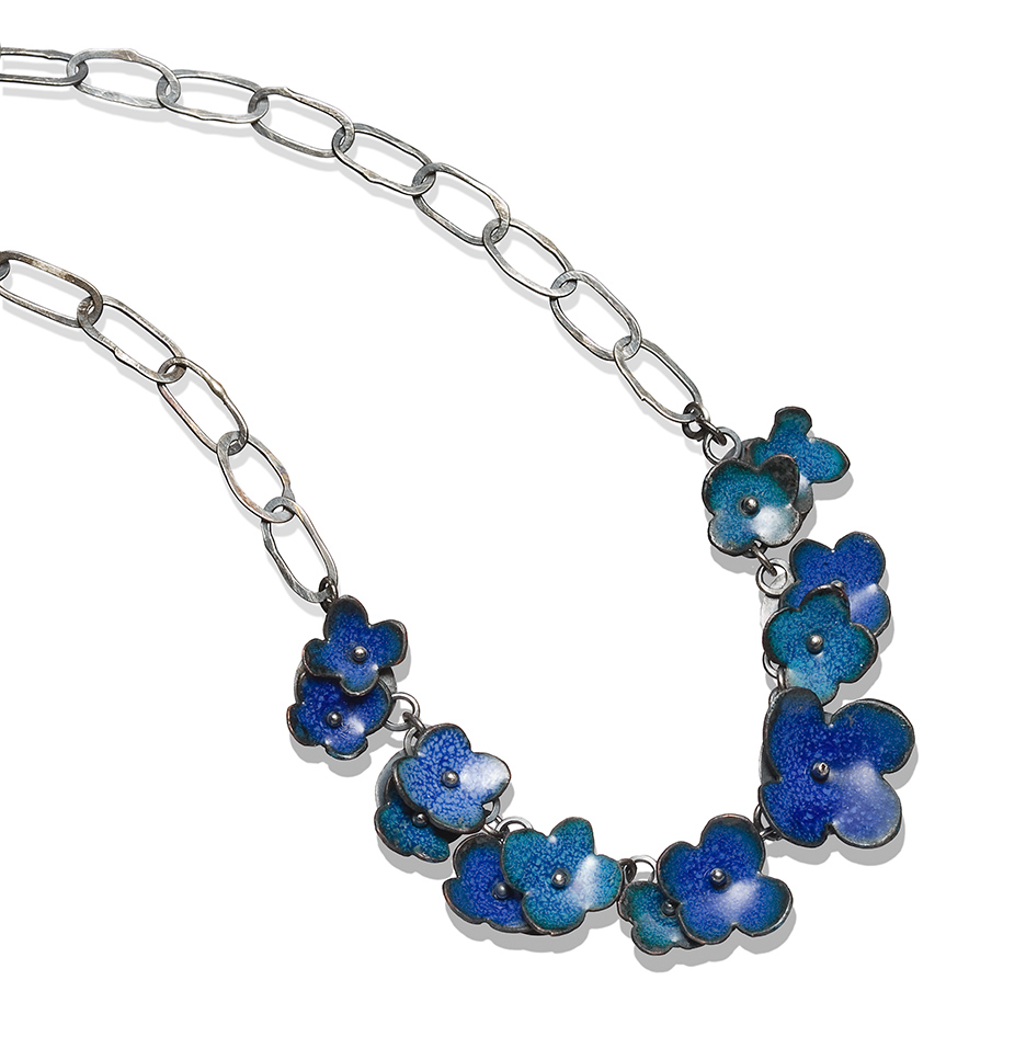 Big floral garland necklace in mixed blues.