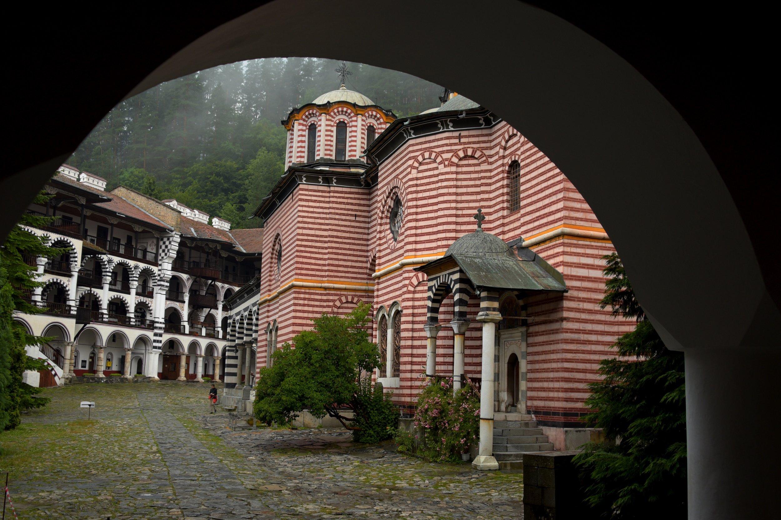 archway-striped-church-black-red-white-cobblestones-rila-monastery-bulgaria-phototours-phil-2016-8840.jpg
