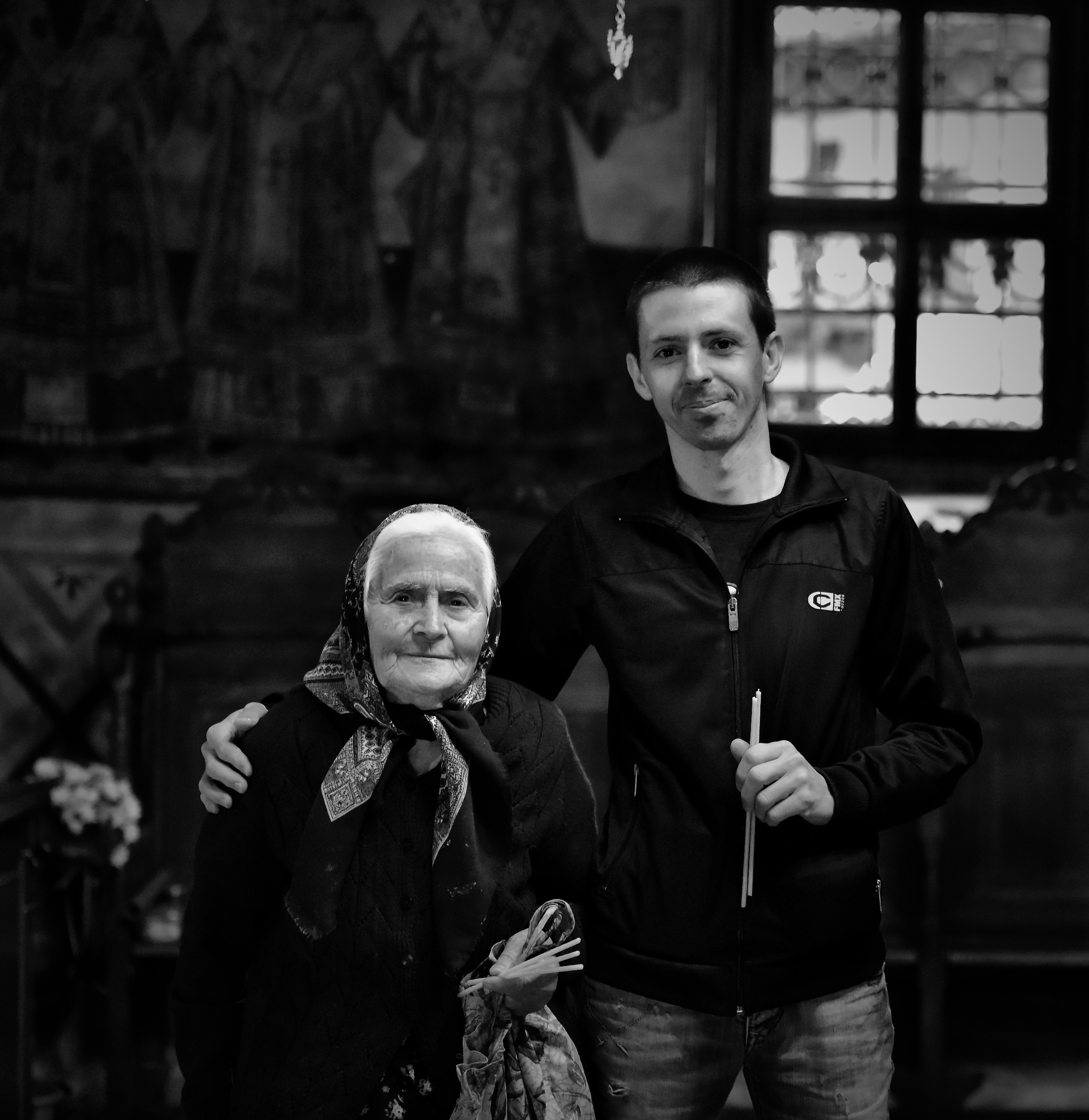 oldandyoung-mother-grandmother-son-church-blackandwhite-troyan-monastery-northloop-phototour-bulgaria-alison-2017-MKH7797.jpg